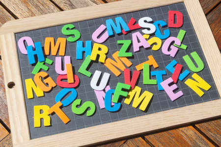 Chalkboard slate and colored letters for children education