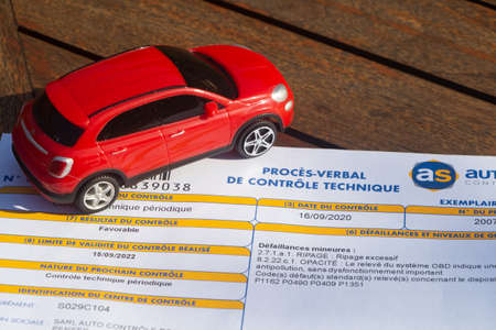 Primelin – France, September 16, 2020 : french motor vehicle inspection and toy car