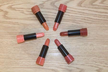 Different colors of lipsticks on wooden background 版權商用圖片