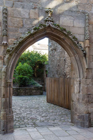 Entrance of a garden in old carved stones