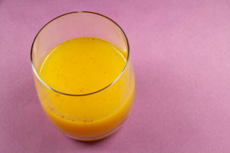 Glass of punch with rum, orange juice and spices Standard-Bild