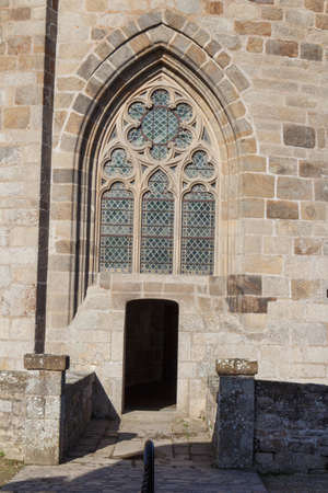 Front view of the door and stained-glass of the castle in Dinan