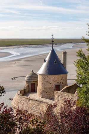 Tower in the ramparts of Mont Saint-Michel with view on the bay