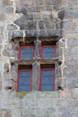 Old window in the wall of a medieval castle
