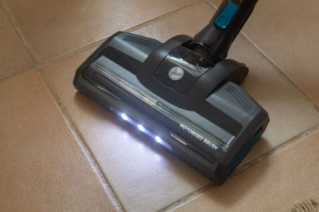 Primelin – France, December 17, 2020 : To vacuum a room with a Hoover vacuum cleaner Editorial