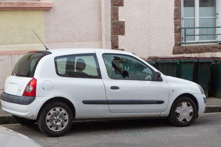 Broken car window after a theft in a street Stock fotó