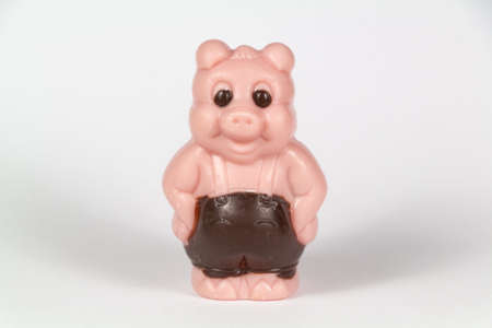 Chocolate pig in white chocolate colored in pink for easter Stock fotó