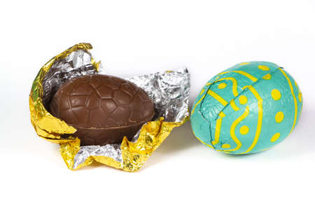 Milk chocolate eggs wrapped in golden and green paper for easter Stock fotó