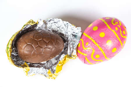 Chocolate eggs wrapped in pink paper for easter