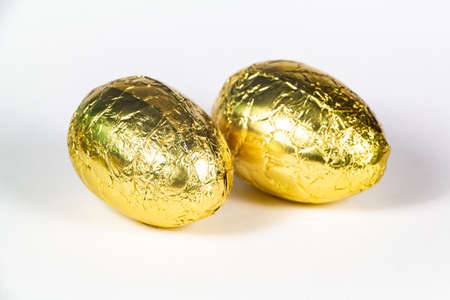 Chocolate eggs in golden paper for easter