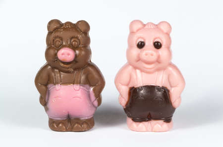 Two white and milk chocolate pigs for easter Stock fotó