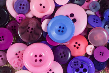Purple, pink and blue sewing buttons background Stock fotó