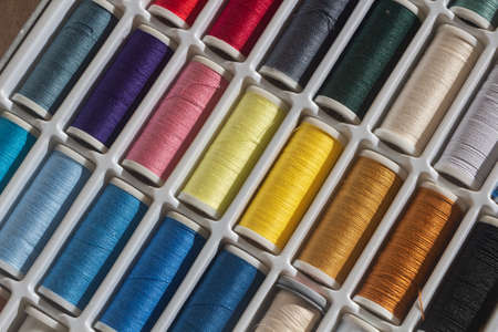 Sewing threads of different colors in a box Stock fotó