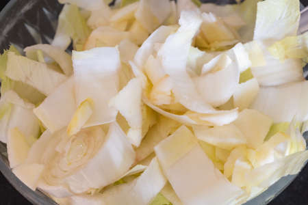 Chopped endive with apple pieces as appetizer