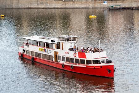 Prague - Czech Republic, August 13, 2019 : Barge carrying tourists on Vltava river in Prague