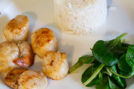 Plate of grilled scallops with rice and lamb's lettuce Stock fotó