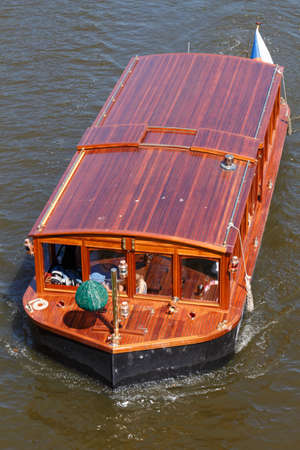 Barge with tourists on Vltava river in Prague