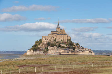 Mont Saint-Michel at low tide during a cloudy day