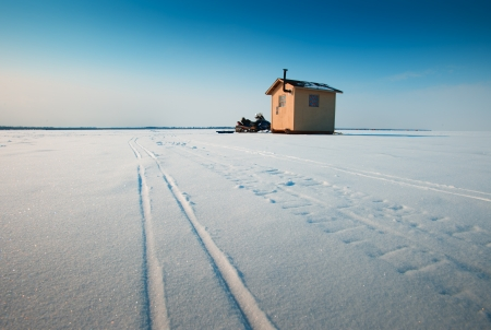 Ice fishing hut on a lake