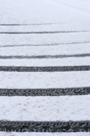 car tire track in fresh snow
