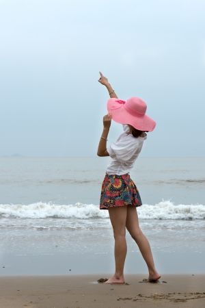 happy woman at the beach photo
