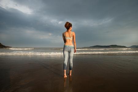 Sport on a beach - beautiful, sexy woman photo