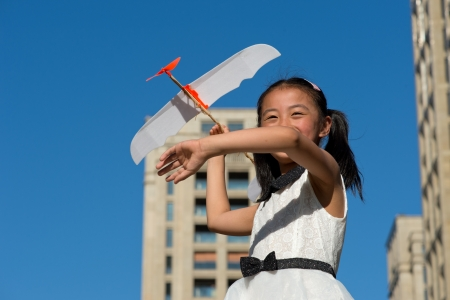Little girl and aircraft photo