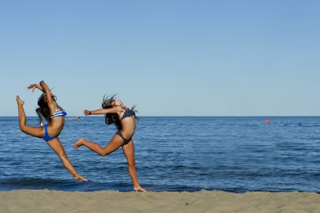 Woman Jumping on the Beach Imagens