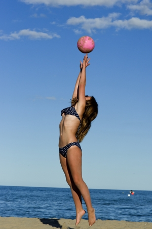 A female volleyball player on a beautiful day  photo