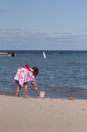 Boy playing on the beach photo