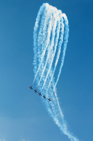 The Canadian Snowbirds demo team in flight - Stock Image