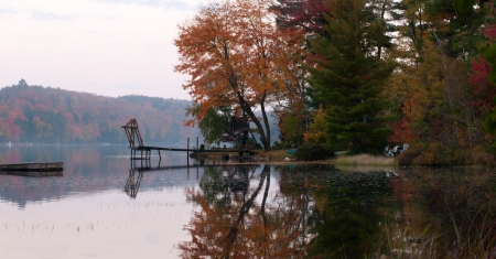 provincial tourist area: Wooden dock on autumn lake Stock Photo