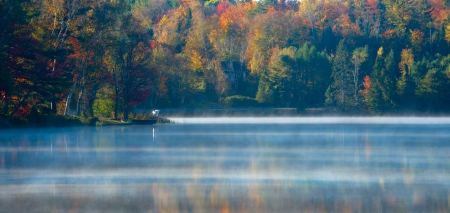 Sunrise and mist in beautiful lake in Algonquin Park photo