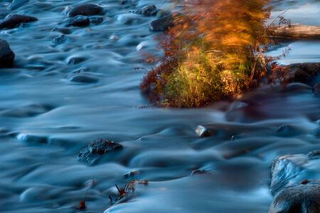 Waterfall in beautiful Autumn setting photo