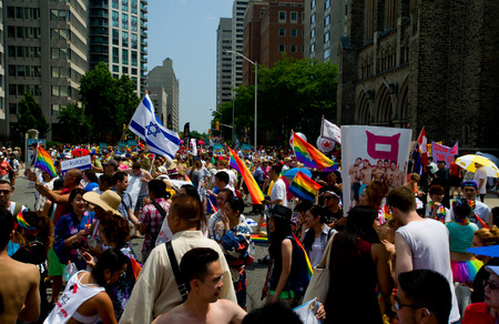 Toronto - June29  Festival goers hold the rainbow banner at the Toronto ,Canada on June 29 , 2014