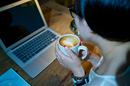 Young businesswoman on a coffee break photo