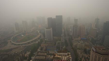 Bird view at chengdu China. Fog, overcast sky and pollution. Фото со стока - 34854870