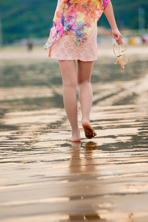 young woman in sea beach with seashell photo