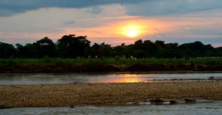 Pirogues on the Rapti river in Chitwan, Nepal photo