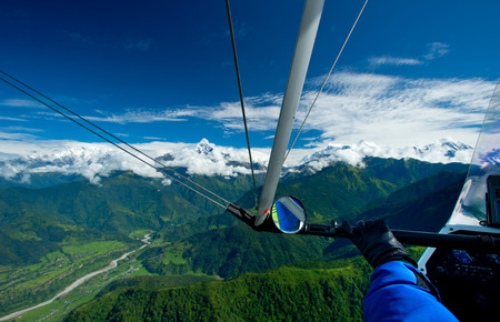 The motor hang-gliding in the sky - Nepal Фото со стока