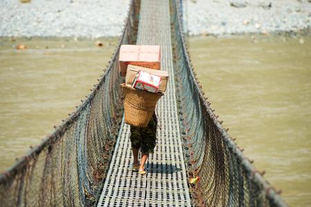 rope hanging suspension bridge in Nepal Stock Photo
