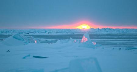 interstice: Ice floe and sun on winter Huron lake