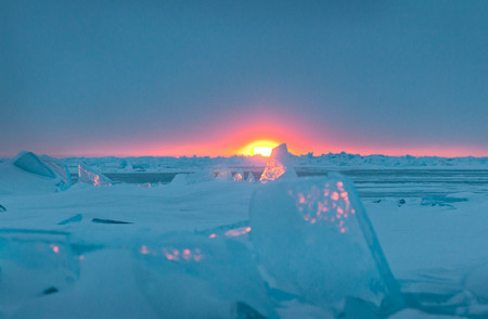 global cooling: Ice floe and sun on winter Huron lake