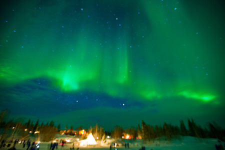 The northern lights stream across the arctic sky near Yellowknife, Northwest Territories in Canada.