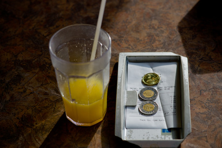 canadian coin: Canadian Dollar and Bills on Restaurant Payment Tray