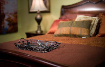 suite: Bed closeup in Bedroom Suite Stock Photo
