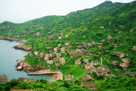 RELOCATED: The decline of fisheries resources, China Zhejiang Shengsi Shengshan Island fishermen have relocated, becoming no village, abandoned houses covered with green plants Stock Photo