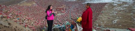Nuns pray in the mountains, the background is the Sichuan Buddhist College, China