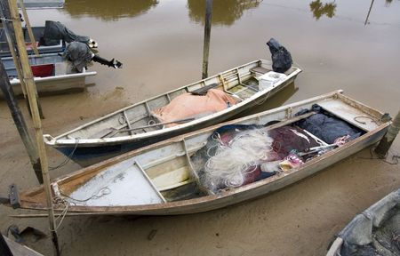 Sungai Duyong, Melacca, August 12, 2010 -  Two Asian fishing boat that parked at a made shift pier during a low tide