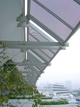 this is on a hotel balcony where the aluminium awning create a unique perspective Banque d'images